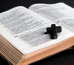 holy bible with stone cross