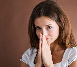 smiling woman praying